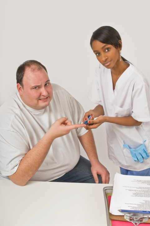 Nurse checking blood glucose
